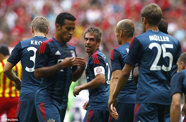 On target: Philip Lahm (centre) struck early on for Bayern Munich as the Germans took control