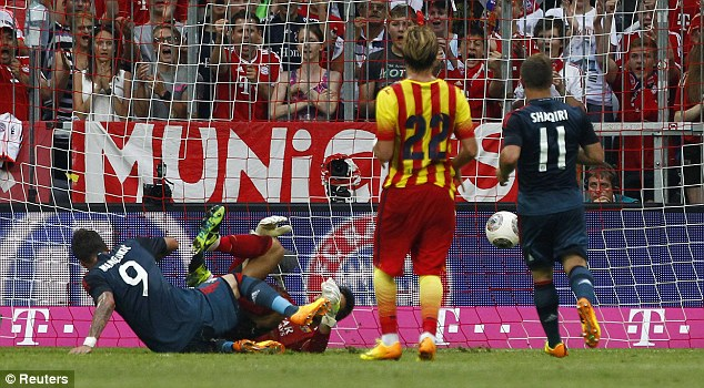 Double up: Mario Mandzukic scored the second from close range to seal the game