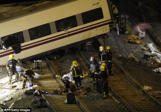 Desperate effort: Emergency crews on the scene checking for survivors of the crash
