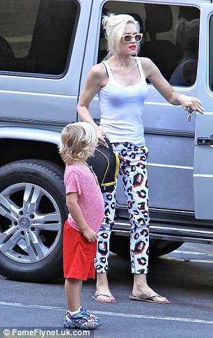 Helping hand: Gwen gets Zuma out of her SUV and off to school