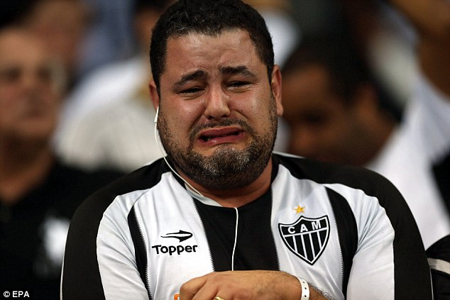 Tears of joy: An Atletico Mineiro supporter can't contain his emotion after the victory