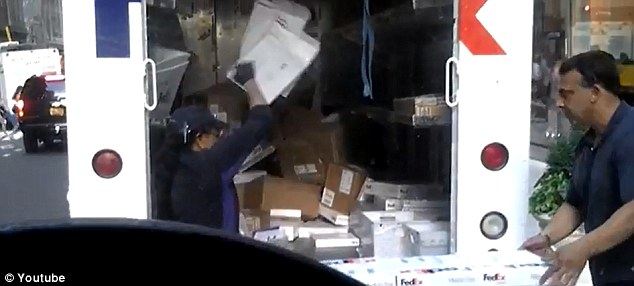 Busted: A FedEx worker was filmed Wednesdaythrowing packages into the back of a FedEx truck in Midtown Manhattan