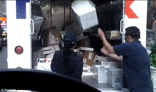 Looks like fun: The man, who doesn't appear to be a FedEx employee, joins in the box-tossing fun