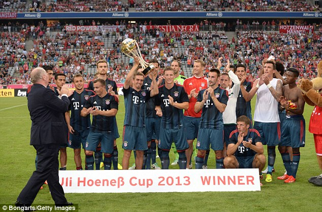 Hoisted high: Bayern were given the Uli Hoeness Cup after their two-goal victory