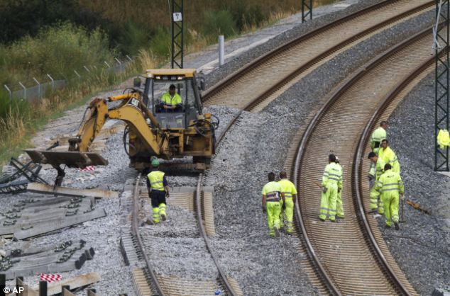 Aftermath: Rail personnel clear the area and fix the track at the site of the accident