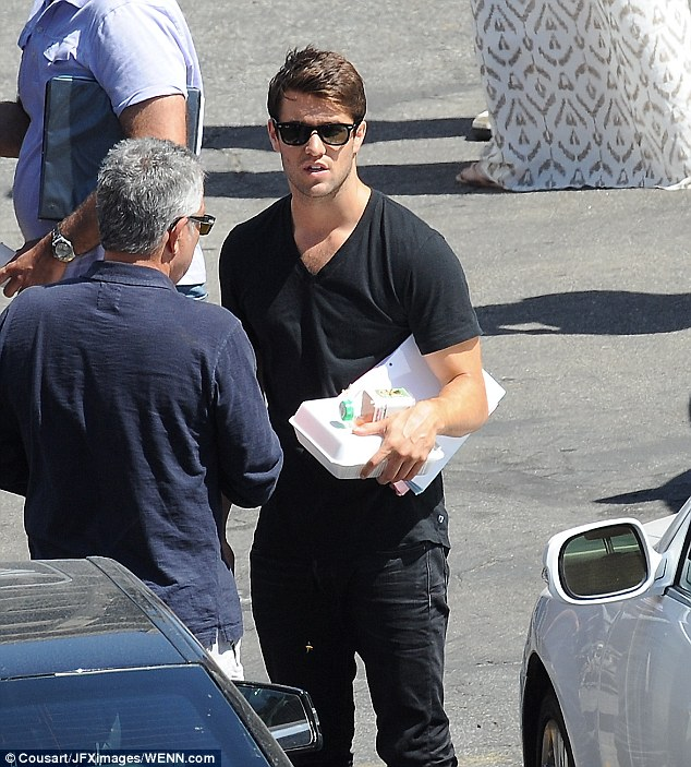 Hungry business: Josh was spotted grabbing some food before his scene