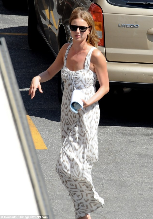 Cool operator: Emily VanCamp dressed for the warm shoot in a summer maxi-style dress