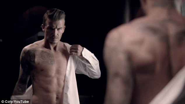 Moody: David Beckham gives his fans a glimpse of his famously honed form in the advert for his new aftershave, Classic