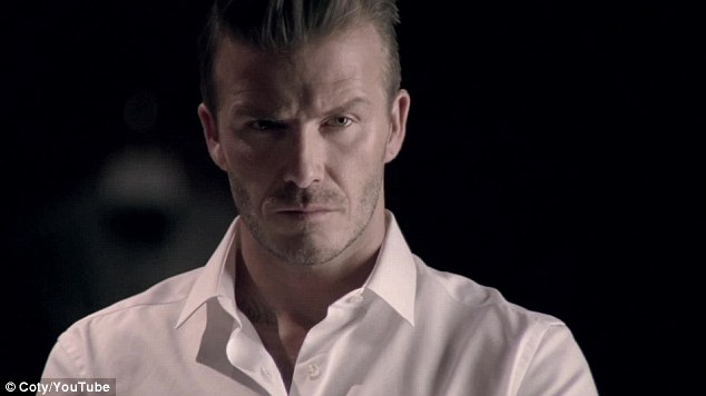 Moody: Becks maintains a serious face throughout as he examines his appearance in the mirror