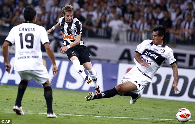 Wanted man: Arsenal sent scouts to watch Atletico Mineiro's Bernard win the Copa Libertadores