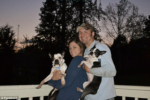 Better times: The happy couple is seen here holding their two dogs