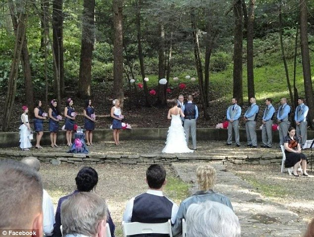 Joyous occasion: The couple was  married in an outdoor ceremony surrounded by family and friends