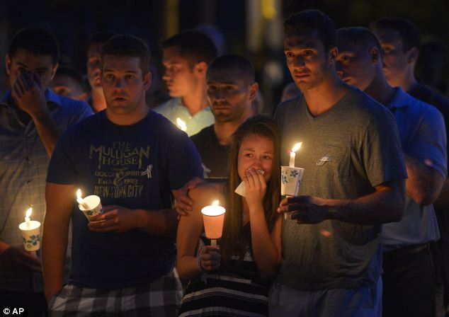 Friends and residents of Wilbraham gather at Gazebo Park for a candlelight vigil for Amy Lord yesterday