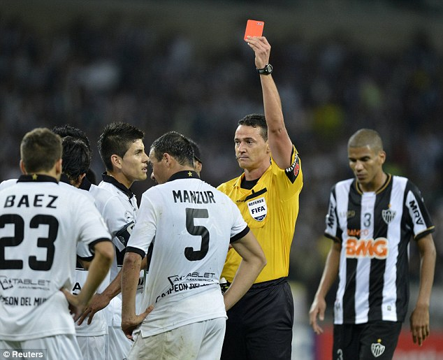 Red mist: Olimpia's Julio Cesar Manzur is sent off after a second yellow card