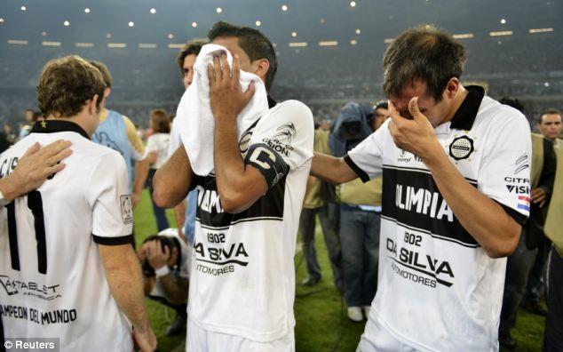 Heartbreak: Olimpia players break down in tears after losing out on penalties