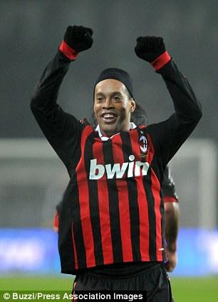 Ronaldinho celebrates a goal for AC Milan