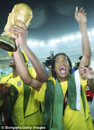 Ronaldinho celebrates with the 2002 World Cup