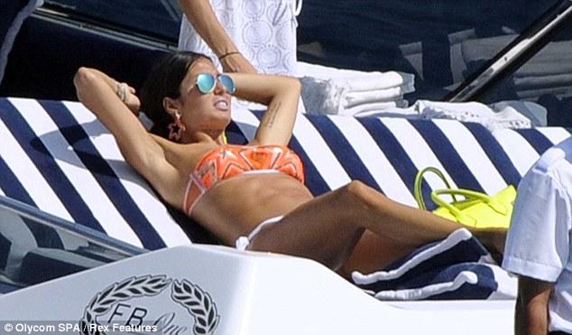 Tantastic: Elisabetta lazes around on the sunbed