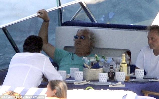 Shady: Flavio Briatore stayed in the shade enjoying a drink