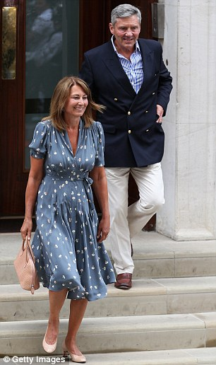 Happy: Carole Middleton and Michael Middleton leave The Lindo Wing after visiting The Duchess Of Cambridge and her newborn son, and now they have them staying with them