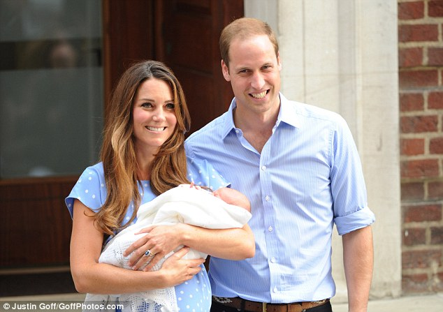 Special moment: Prince William and Kate waved and smiled broadly as they carried their son George out of hospital for the first time
