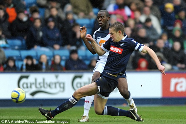 Making the tackle: Paul Robinson wins the ball from Fabrice Muamba
