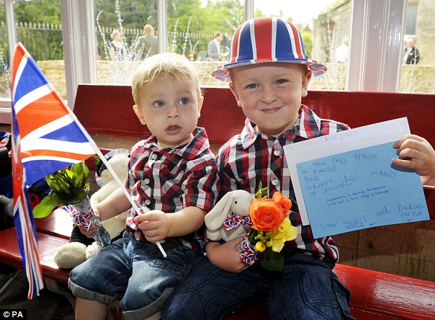 Special: Oliver and Daniel Horne waiting for the arrival of the Prince of Wales at Kemble train station, the closest to Charles's Highgrove home, which he was visiting to officially open a new garden