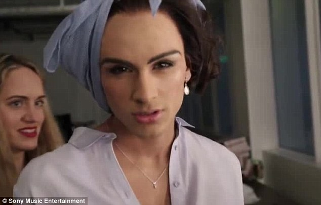 Zayn dresses as a woman in the light-hearted new video from One Direction