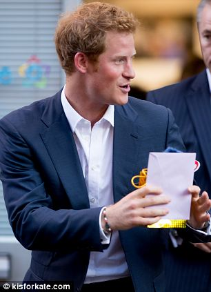 Prince Harry brandishes the gift