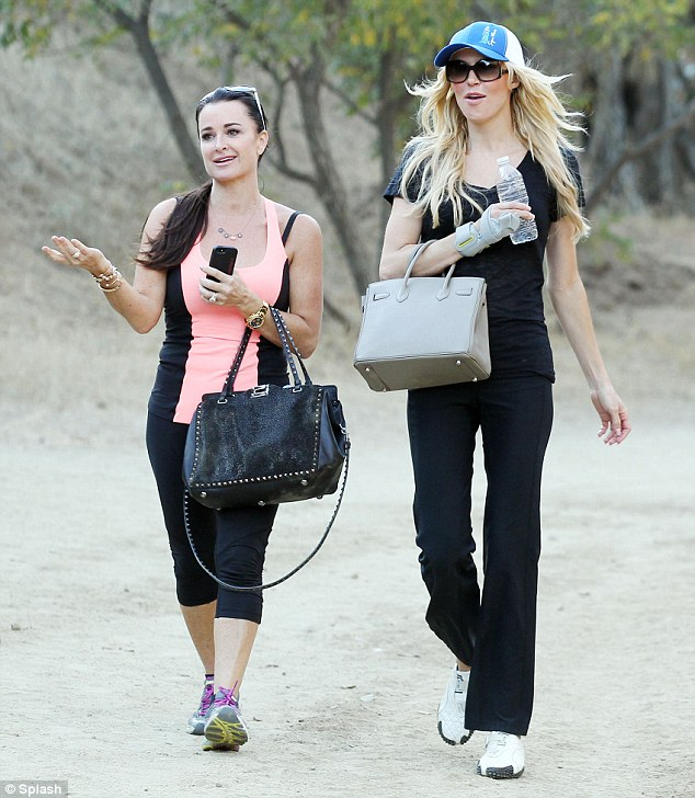 Purse priorites: Even a tough hike didn't deter Brandi Glanville and Kyle Richards from bringing their handbags up Hollywood's Runyon Canyon on Wednesday
