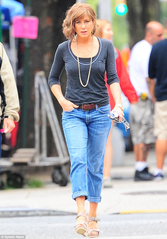 That's more like it: Earlier in the day, Jennifer was spotted wearing jeans, sandals and a grey jersey top