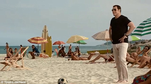 Serendipity: Travolta stumbles upon a football on the beach