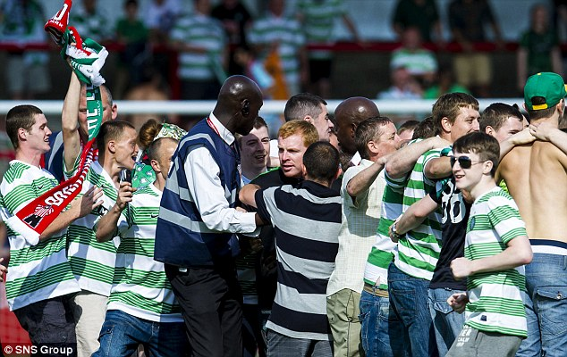 Mobbed: Neil Lennon after fans invaded the pitch in a pre-season game against Brentford