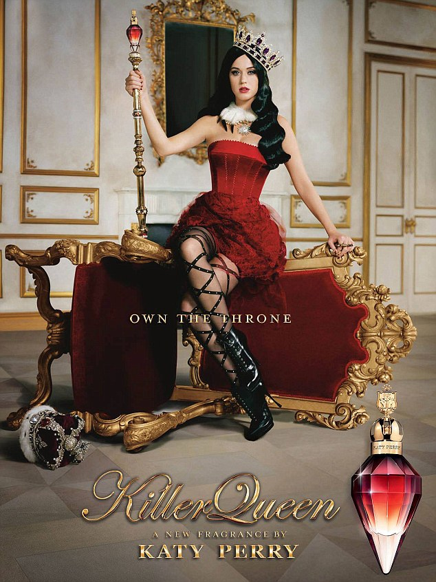 Killer queen! Katy Perry shows off her tiny waist in a corset and ruffled skirt as she perches on the side of an upturned throne for her new perfume advert