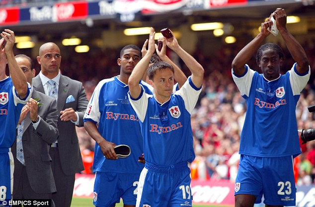 Part of the team: Dennis Wise lead Millwall to the FA Cup final in 2004 - Robinson missed the final through injury