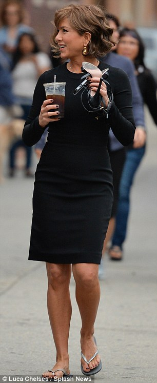 Fine figure: Jennifer was certainly looking as shapely as ever in this pleasantly tight dress