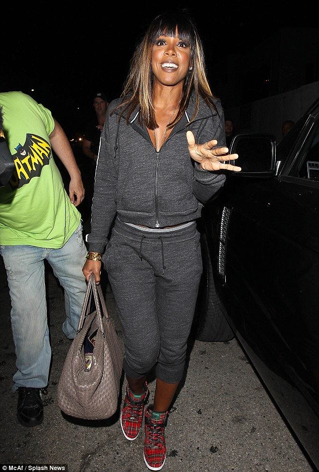 Embarrassed: Kelly didn't seem to happy to be seen in the sporty outfit