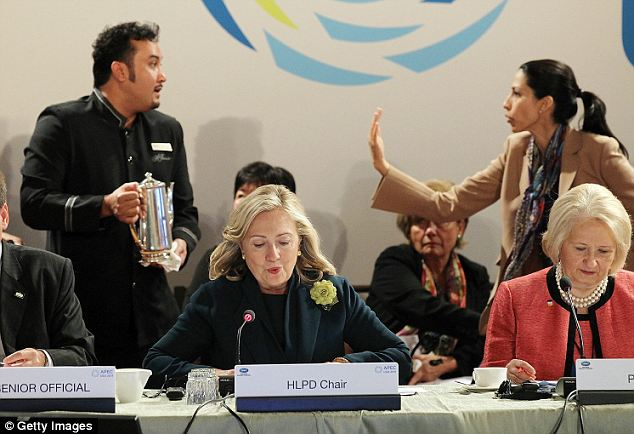 No more: Mrs Abedin, seen here telling a coffee server to move during a conference in San Francisco, has worked for Mrs Clinton in various capacity since 1996