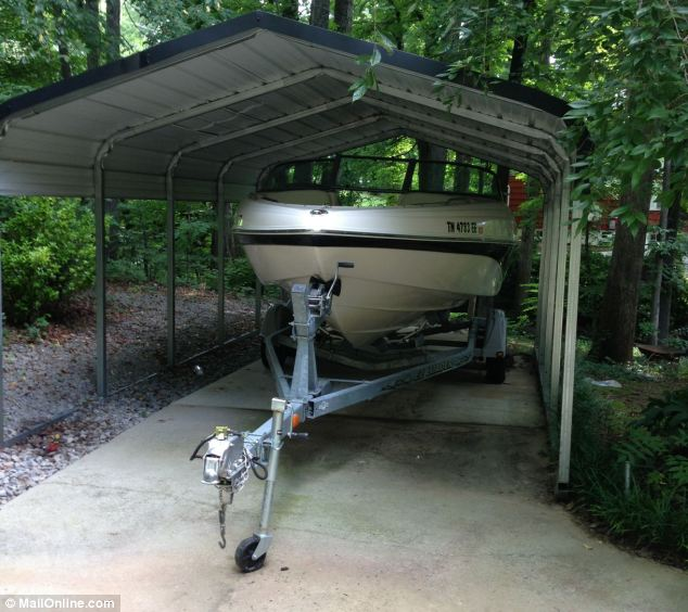 The white Rinker speedboat that was the cause of the couple's argument now sits idle in the driveway of their $250,000 home in a quiet suburb of Knoxville