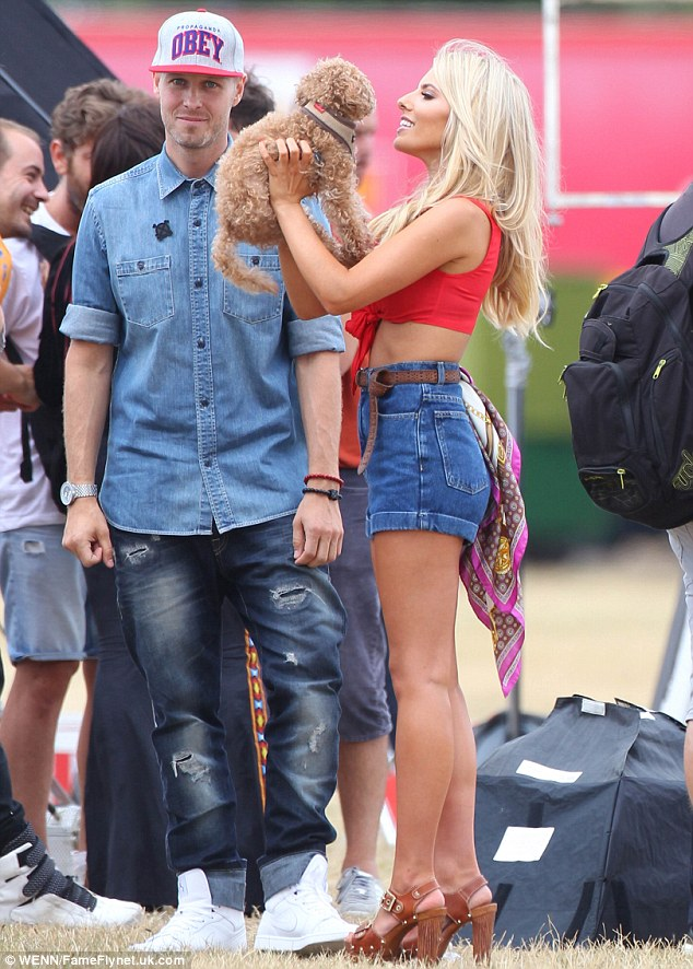 The look of love: Mollie gazed at her pet pooch, while her boyfriend Jordan Omley looked on