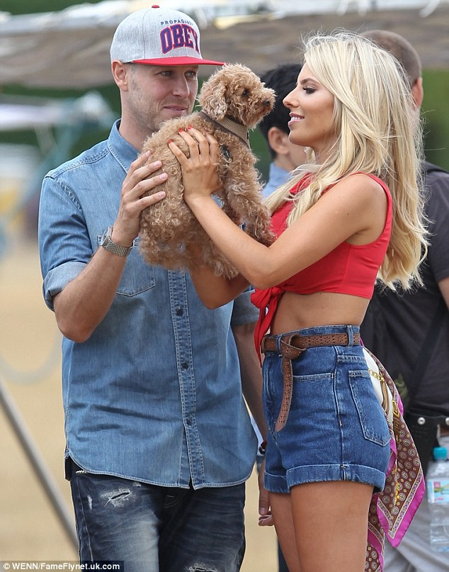 He's a fan: Jordan clearly gets along well with Mollie's dog Alfie as he spent plenty of time with the pooch