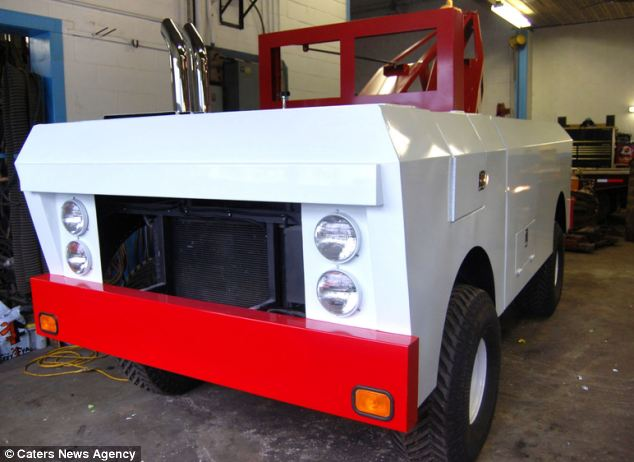The end result is a huge Tonka wrecker that is 16-foot-long, 10-foot-tall  and weighs 2 tons