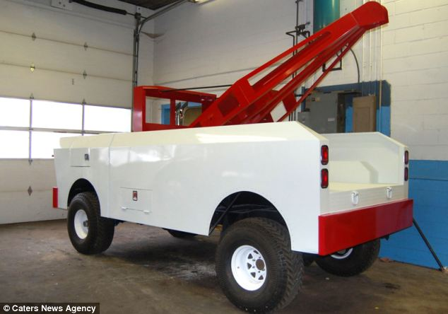 Brad Doane has faithfully re-created the tow truck, even down to the mini cab and hand-cranked winch at the back