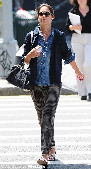 Sweating yet? The 34-year-old actress was dressed a tad warm for the 83-degree weather in a chambray shirt under a knit navy cardigan and grey-checkered trousers