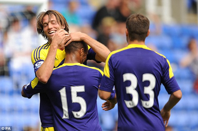 Spanish sensation: Swansea Michu celebrates with Wayne Routledge after scoring their opening goal