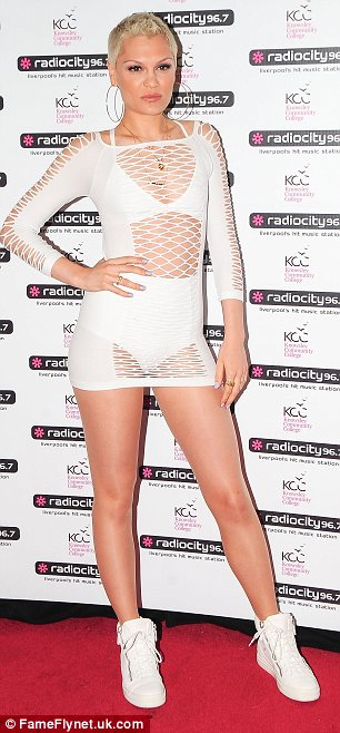 Keeping it comfy: Jessie wore a pair of white trainers to perform at the Liverpool Echo arena