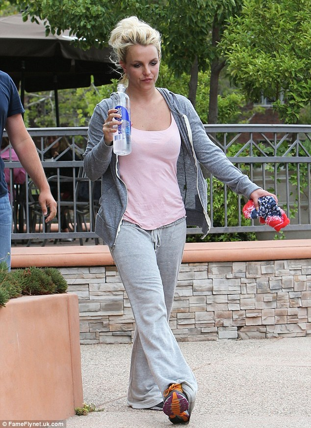Intense: Britney was perspiring and carrying what looked like a sweat-soaked bandana as she left the studio with a bodyguard