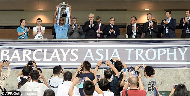 Up for the cup: Vincent Kompany lifted the Barclays Asia trophy, but will hope he's holding more come May