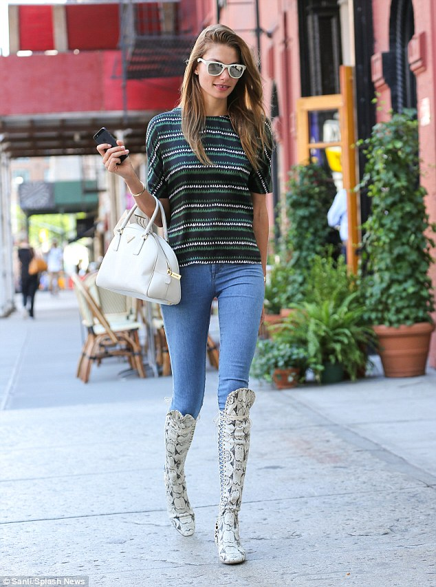 Impact: Model Jessica Hart wore a pair of knee-high snakeskin boots as she strutted around New York on Friday