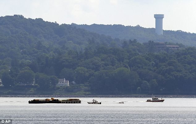 Fearing the worst: Rescue workers are seen on boats near a barge on the Hudson River south of the Tappan Zee Bridge during the search